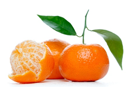 Tangerines with leaves isolated over white