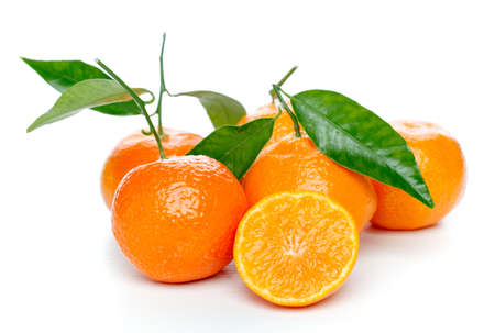 Tangerines with leaves isolated over white photo
