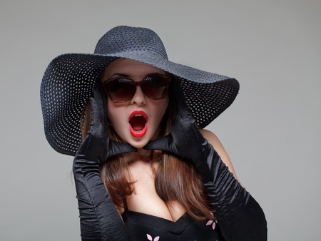 Young woman in black hat and sunglasses .  Stock Photo - 8996955