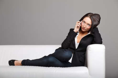 Young woman talking over the phone Stock Photo - 8996696
