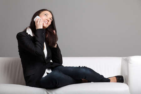 Young woman talking over the phone Stock Photo - 8996595