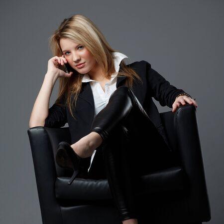 cross leg: Woman talking over the phone