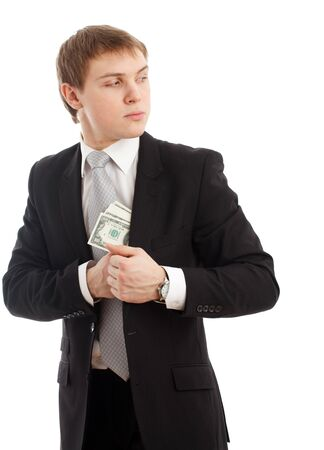 Man in a putting money in his pocket. Isolated over  white Stock Photo - 8996600
