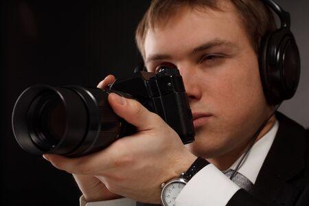 Spy with camera. Stock Photo - 8996767