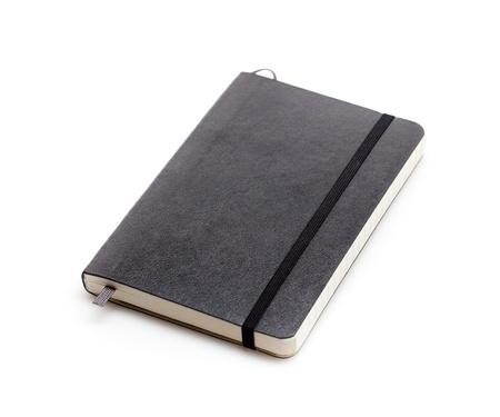 notebook cover: Black moleskine isolated over white.