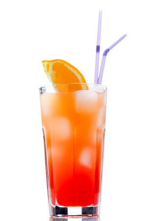 fruit of the spirit: Tequila sunrise with sliced orange. Cocktail isolated over white.