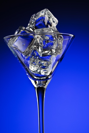 Martini glass with ice photo