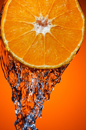 Orange with water splash Stock Photo - 9317375