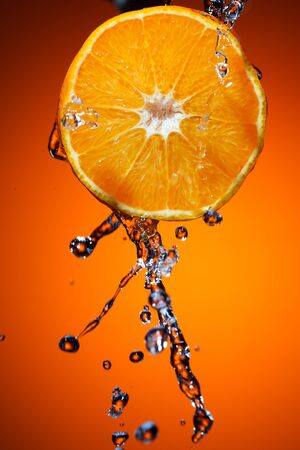 Orange with water splash photo