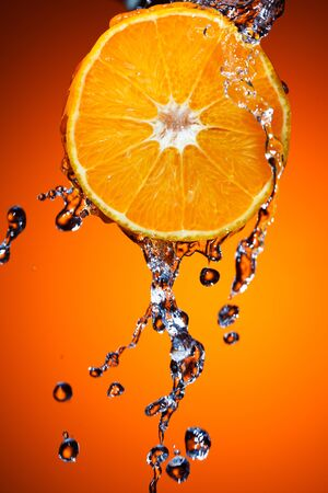 Orange with water splash photo