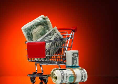 Market cart over color background photo