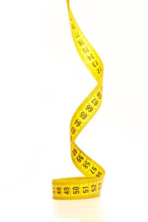 volute: Measure tape. Isolated over white. Stock Photo