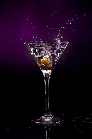 martini splash: martini over dark background