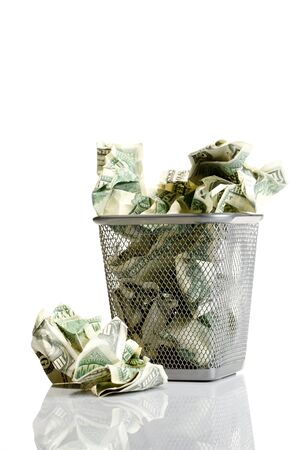 consummation: Money in basket. Isolated over white.