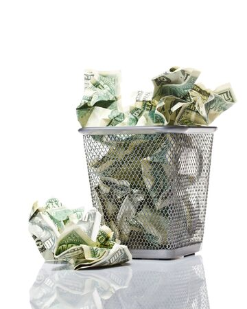 bucket of money: Money in basket. Isolated over white.