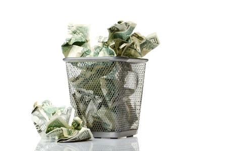 needless: Money in basket. Isolated over white.