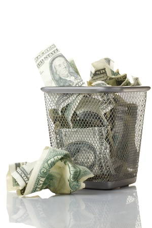 rubbish bin: Money in basket. Isolated over white.