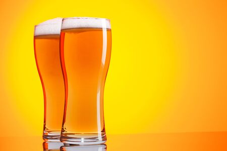 mug of ale: Two glasses of beer Stock Photo