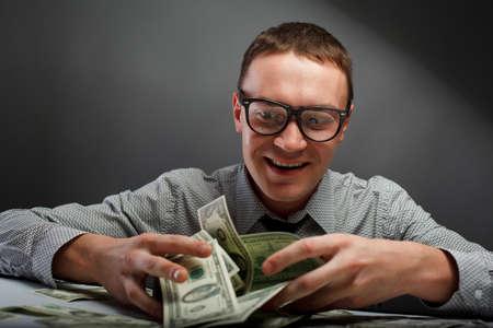 Happy man with money photo