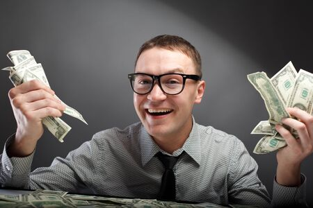 greed: Happy man with money
