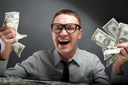 Happy man with money photo