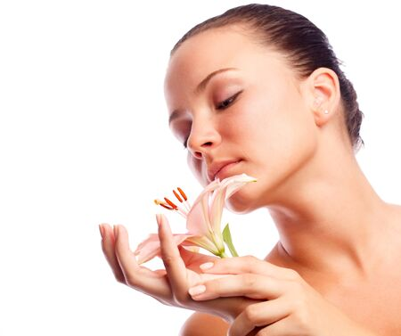 Woman with flower in hands photo