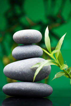 Massage stones with bamboo photo