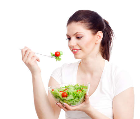 Young woman with healthy salad. Isolated over white. photo