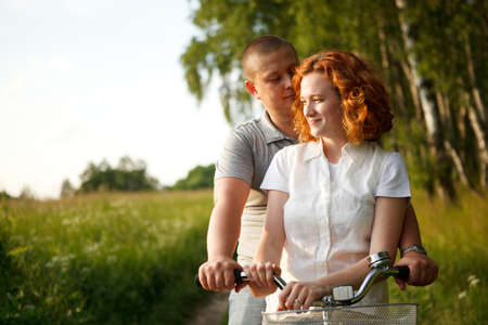 Young couple sitting at one bicycle Stock Photo - 9996609