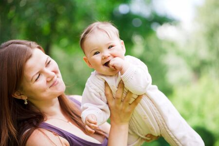 Mother with baby at outdoors photo