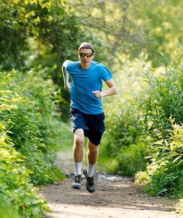 young jogger runnig at the park photo
