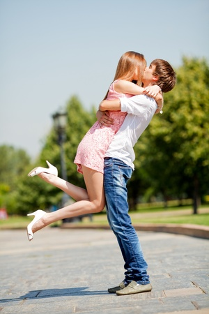 young couple kissing: Kissing couple Stock Photo