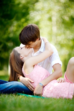 Young couple at green grass. Stock Photo