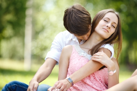 relationship love: Young couple at green grass. Stock Photo
