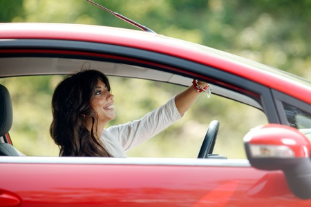 positivism: Young pretty woman in the red car