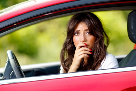 Young pretty scared woman in the car Stock Photo - 10223037