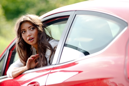 back seat: Young pretty woman looking at back of car