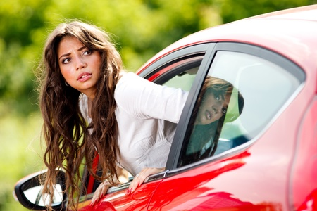 Young pretty woman looking at back of car Stock Photo - 10222965