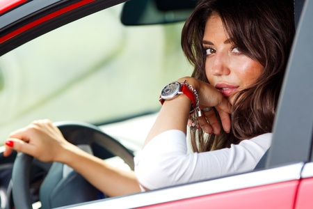 Portrait of young pretty woman in the red car Stock Photo - 10223011