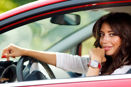 Portrait of young pretty woman in the red car Stock Photo - 10222963