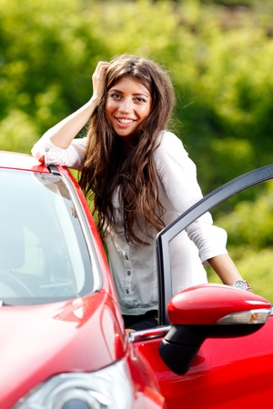 Young pretty woman in the red car Stock Photo - 10222964