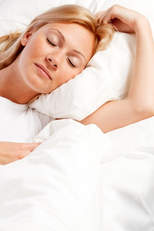 counterpane: Young woman in bed.