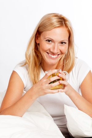 counterpane: Beautiful woman with cup of tea Stock Photo