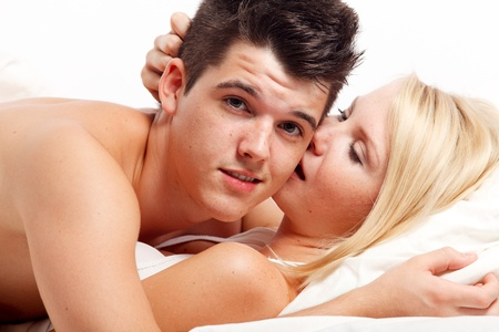 adult sex: Loving affectionate heterosexual couple on bed.