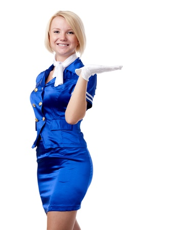 Beautiful stewardess. Holding in hand something. photo