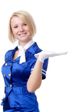 Beautiful stewardess. Holding in hand something. photo