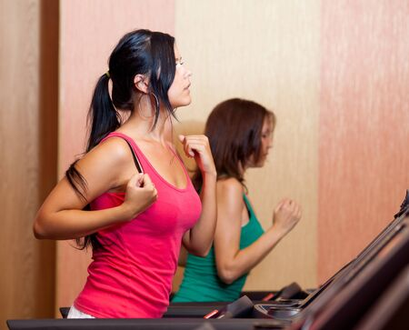 Young women on a running simulator photo