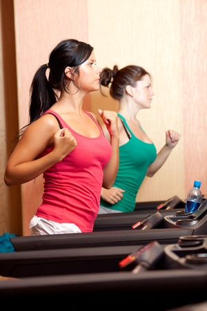 Young women on a running simulator Stock Photo - 10586260