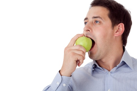 Man with green apple. Stock Photo - 10585938