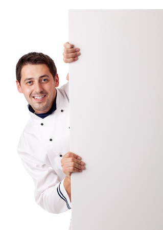 Male chef holding blank board. Isolated over white.